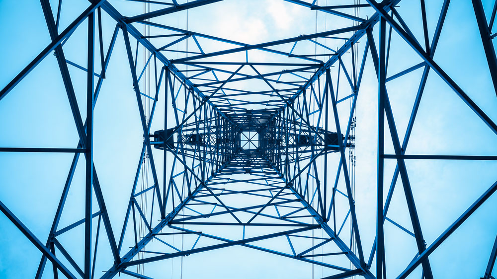 Upward view of a electrical transmission lattice tower